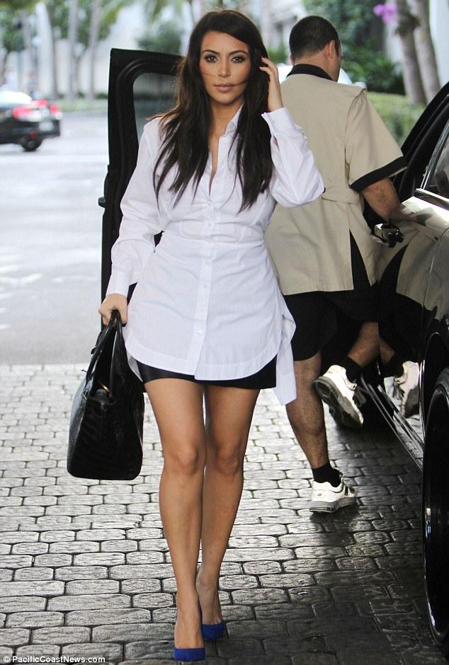 Legs eleven: Kim Kardashian showed off her legs in a leather mini skirt in Miami, Florida on Saturday