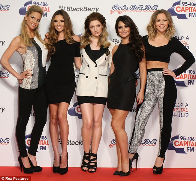 Back with my girls: Cheryl Cole returned to the Jungle Bell Ball on Sunday with her Girls Aloud bandmates