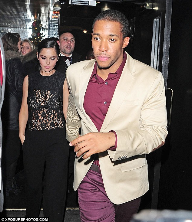 Happy holidays: Cheryl was being escorted around by Tre as the couple were pursued by fans