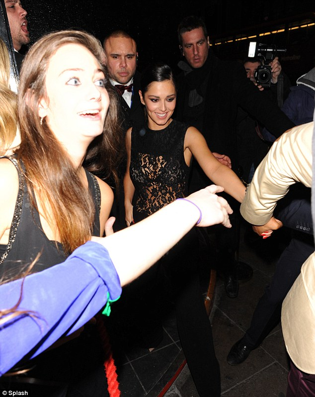 Main attraction: Cheryl was seen giggling as she left the club with boyfriend Tre leading the way