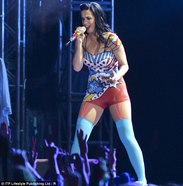 Theme dressing: Katy's racy outfit featured shoulder-detailing in the design of tiny sparkling and multi-coloured balloons