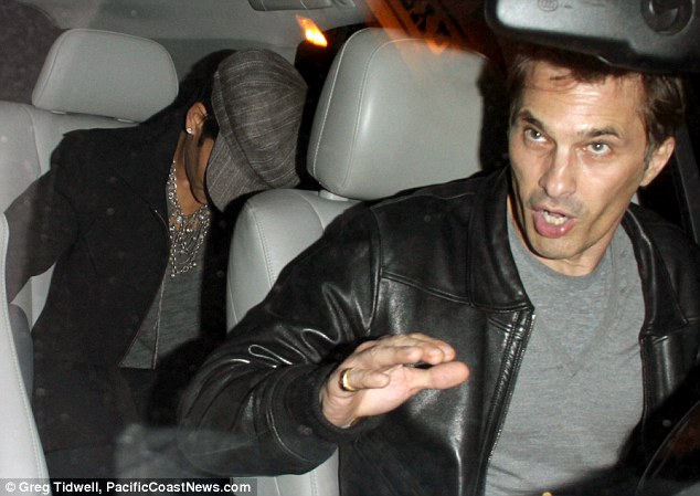 Blood sport: Olivier Martinez and Halle Berry reportedly watched the Juan Manuel Marquez versus Manny Pacquiao boxing match in Los Angeles last night