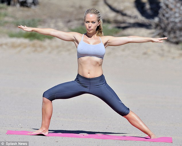 Getting zen: Kendra also rolled out her exercise mat and did eloquent yoga moves and deep breathing as she took in the sights of the sea