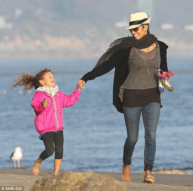 Barefoot stroll: Halle Berry and Nahla enjoyed a stroll along the coastline in Malibu on Sunday