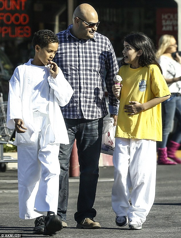 Indulging: Accompanied by a pal and his bodyguard, the 10-year-old son of pop star Michael Jackson had literally gone from the dojo at Dawn Barnes Karate Kids directly to Baskin-Robbins