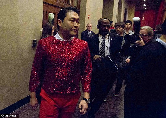 Cool yule: Korean rapper Psy looked to be getting into the spirit of the occasion with his sequinned red sweater