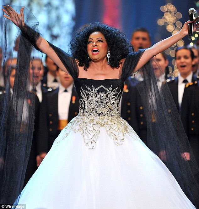 Star of the show: The iconic singer looked dressed for the occasion in her black and white strapless dress with silver embroidery