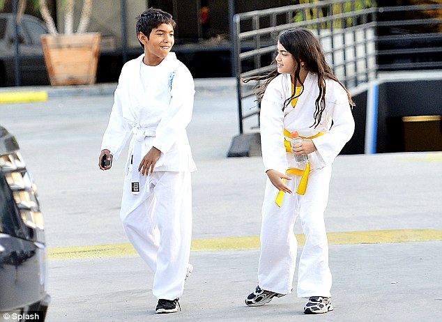 Regal pair: The long-haired boy left the dojo alongside his cousin Royal, the grandson of Tito Jackson