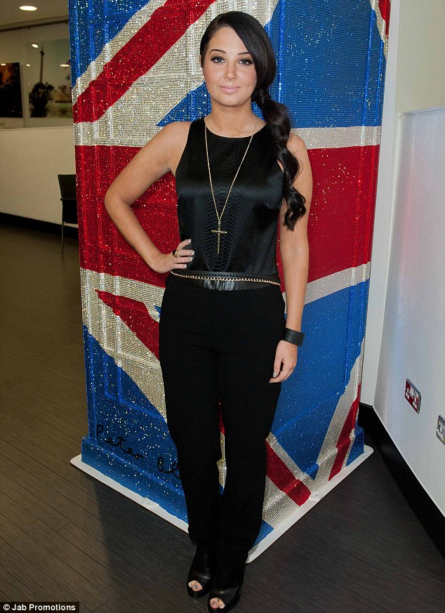 Low key look: Tulisa looks modest but stylish in her low key outfit
