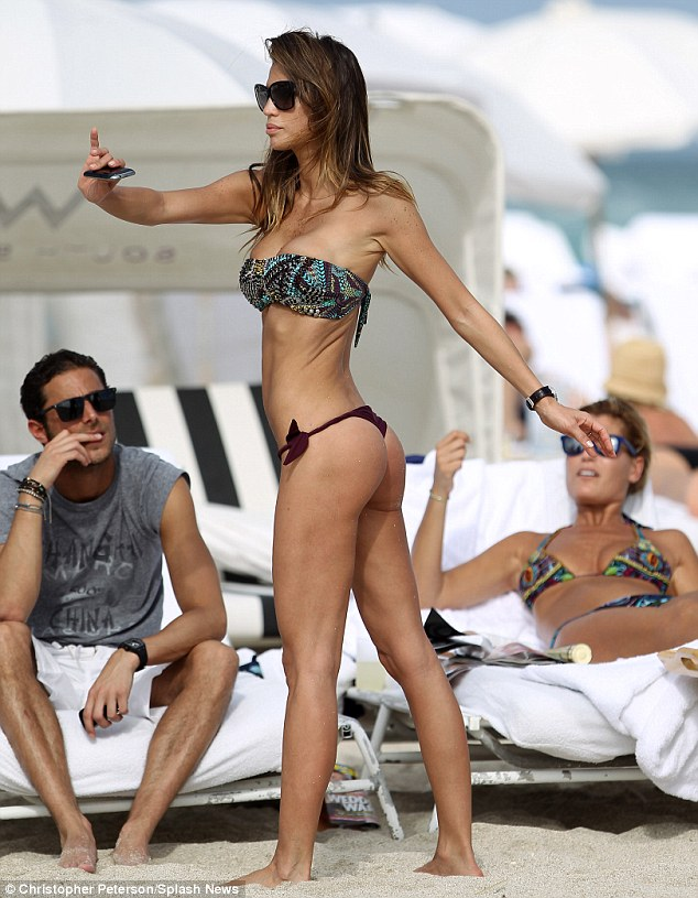 Keeping in shape: Paraguayan model Claudia Galanti shows off her moves to an appreciative audience