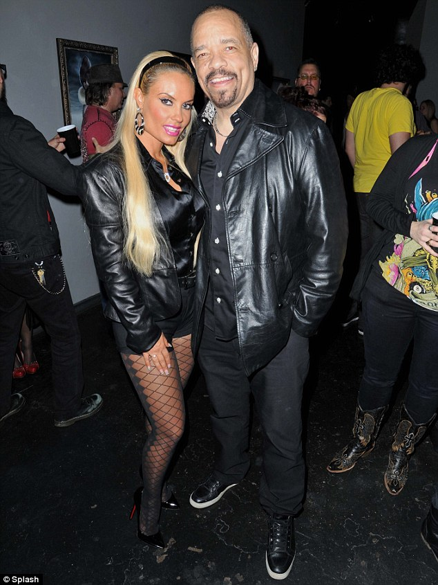 Brave face: Ice-T and Coco put on a brave face together at an art gallery in New York on Monday night in the wake of her being embroiled in a scandal over photos of her smooching with another rapper
