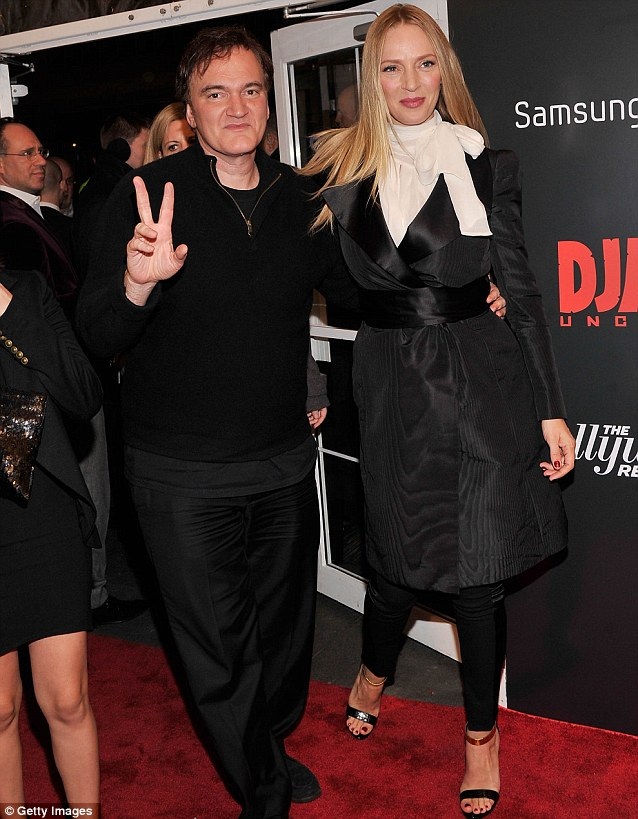 Great friends: Quentin wrapped his arm around Uma's waist and offered a peace sign to photographers before escorting the actress into the theatre