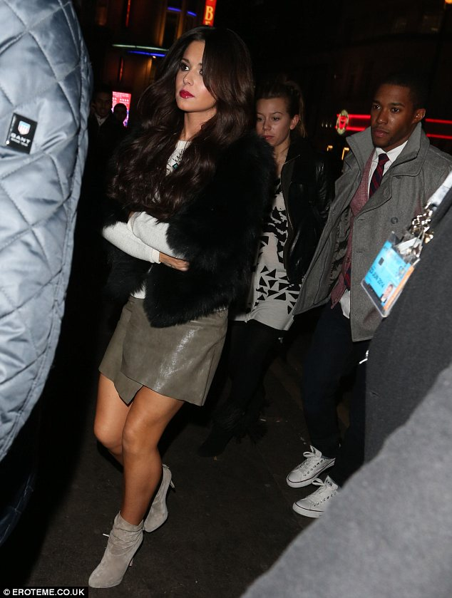She is a Northern girl: Cheryl didn't wear tights and showed off bare legs in her olive skirt