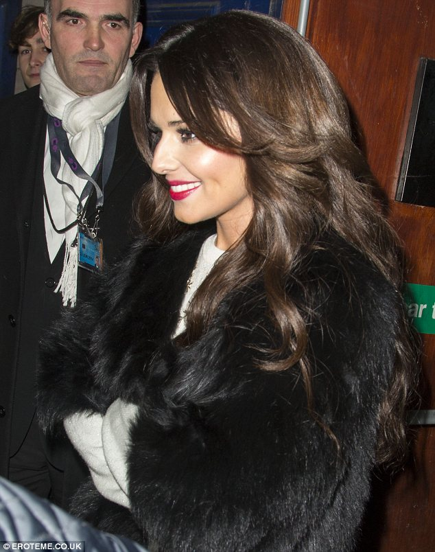 Hair perfect: The star had her new extensions teased into loose curls falling around her shoulders