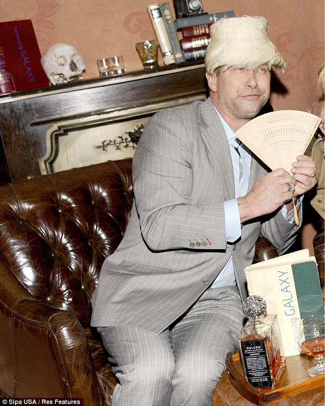 Getting in the spirit: Stephen Baldwin seems to be having his own fun in a feather hat