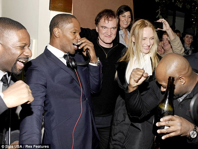 Getting the party started: Jamie Foxx takes to the DJ booth at the Django Unchained afterparty as Uma Thurman, Quentin Tarantino and DJ Irie look on