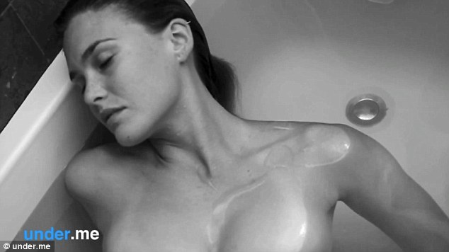 Amazonian: The statuesque beauty is shown submerged in the bath completely naked