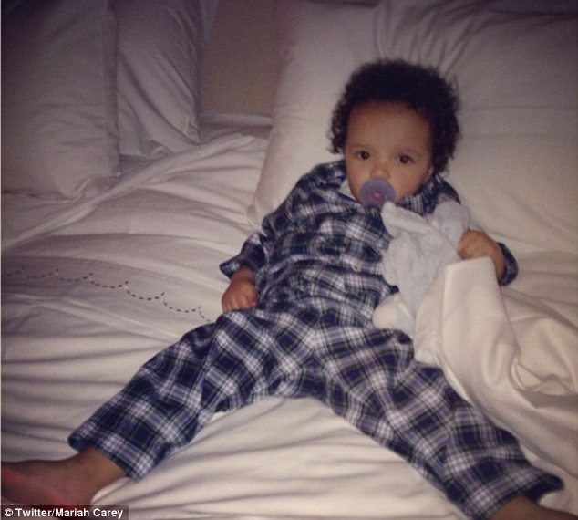 Just chillin': Wednesday night it was Moroccan's turn and the doting mother-of-two posted a photo of the boy reclining with his legs comfortably spread out on a big bed
