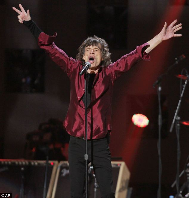 Rock n roll man: Mick Jagger of The Rolling Stones throws his hands in the air as he sings to Madison Square Garden