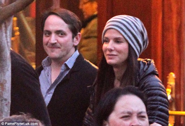 Dpting husband: Ben Falcone was also present and chatted to Sandra as they strolled through the park
