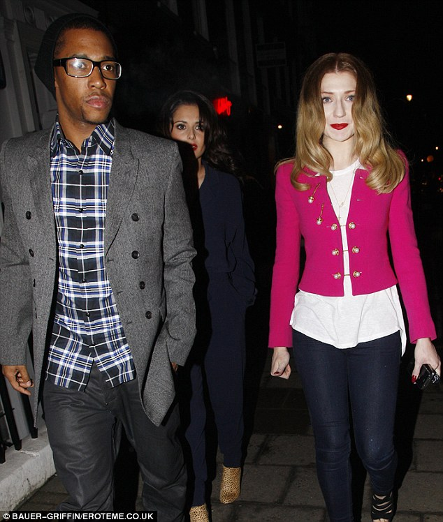 Three's company... Cheryl's boyfriend Tre Holloway joined the girls on their night out and escorted them out of the venue