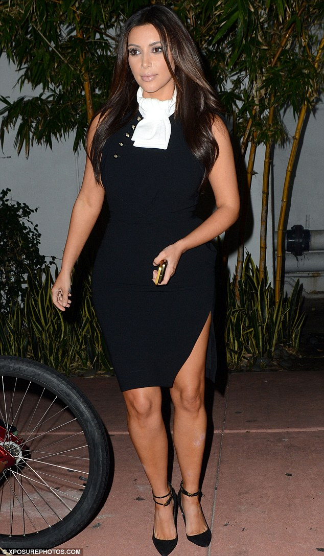 Part of her Kollection? Kim Kardashian donned a bib over her LBD as she attended the restaurant opening of her chum Jonathan Cheban in Miami