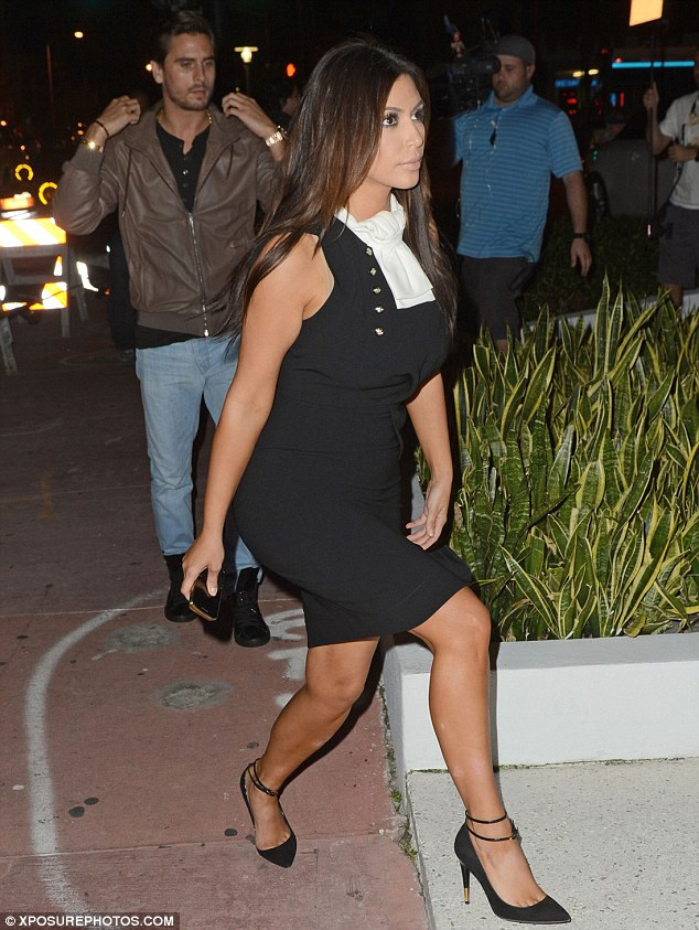 Night out with the family: Kim was joined by brother-in-law Scott Disick as she visited the restaurant in Miami