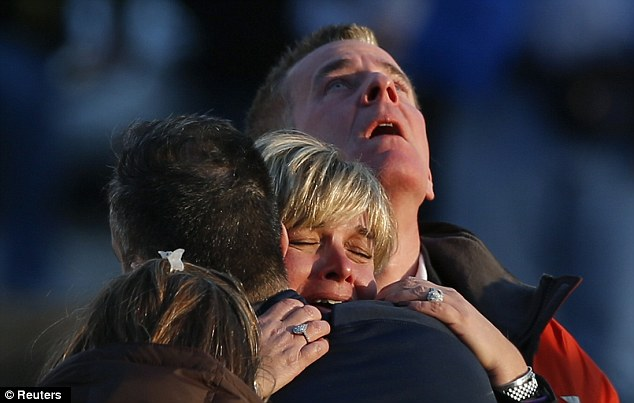 The families of victims grieve near Sandy Hook Elementary School. Piers Morgan felt deeply affected by the tragedy