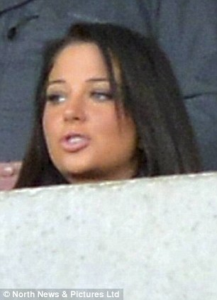 Tense: Tulisa was seen biting her bottom lip as she paid close attention to the game