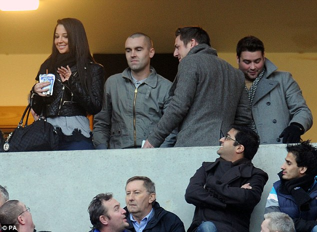 Saying hi to everybody: Tulisa waved at people in the crowd as she held a pouch of Capri-Sun