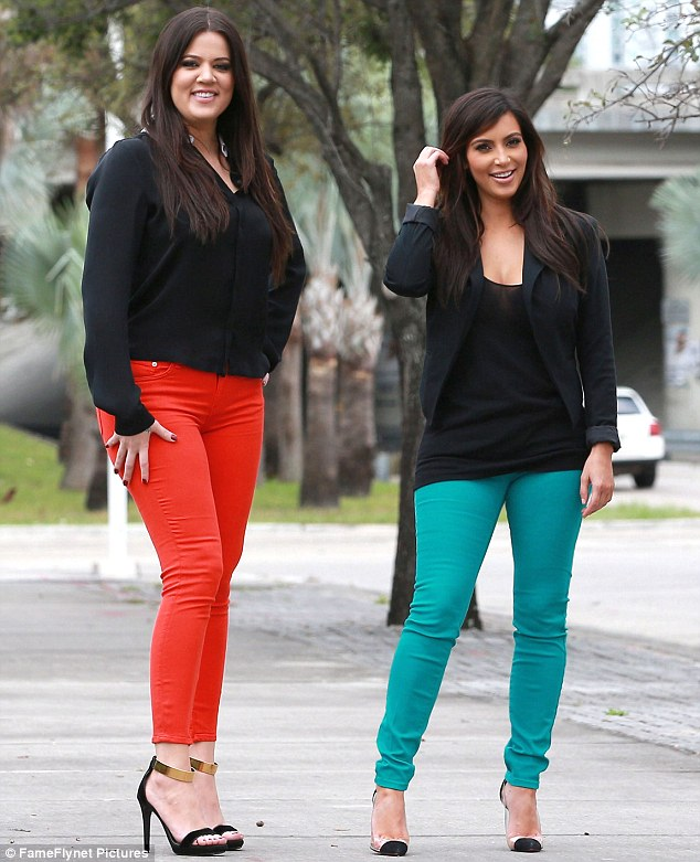 A perfect match: Khloe and Kim Kardashian showed off their flare for colourful fashion during a reality television shoot on Saturday in Miami, Florida
