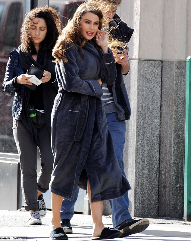 Under cover: Sofia Vergara was hiding her outfit under a bathrobe on the set of her latest Pepsi commercial in Los Angeles on Saturday