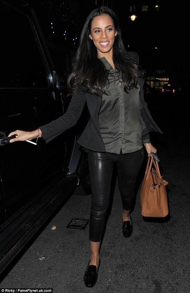 On the go: Rochelle wore a black blazer with khaki shirt and a cropped leather trousers