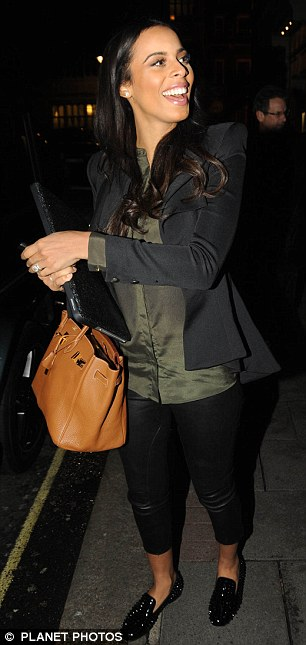 In good spirits: Rochelle beamed as she showed off her tiny baby bump