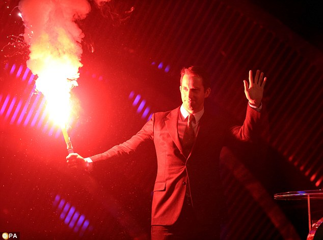 Blazing entrance: Four-time Olympic gold medal sailor Ben Ainslie, who is on the award shortlist, walks on stage carrying a flare