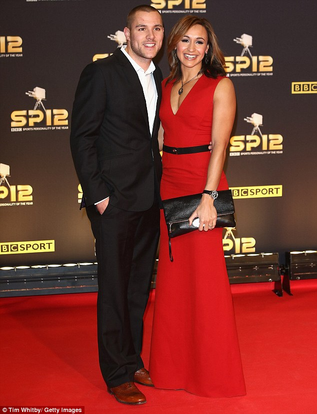 Winning in the fashion stakes: Jessica looked ravishing in her scarlet number as she posed up next to fiance Andy Hill