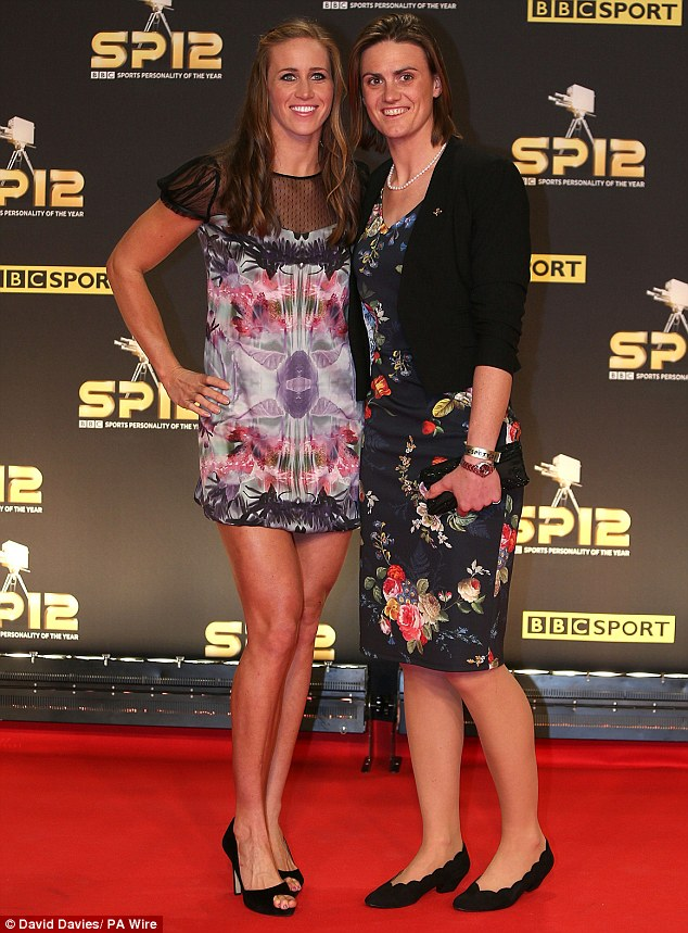 Splashes of colour: Both Helen Glover and Heather Stanning went for printed frocks as they posed up together on their way in