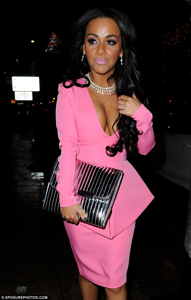 Pink overload: Chelsee Healey shows off her cleavage in a revealing bright pink outfit as she hits the town in Manchester yet again