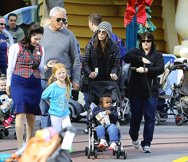 We're with Mickey: The famous families were accompanied by a plaid-vested employee, who was surely giving the two Hollywood stars the Disney VIP treatment