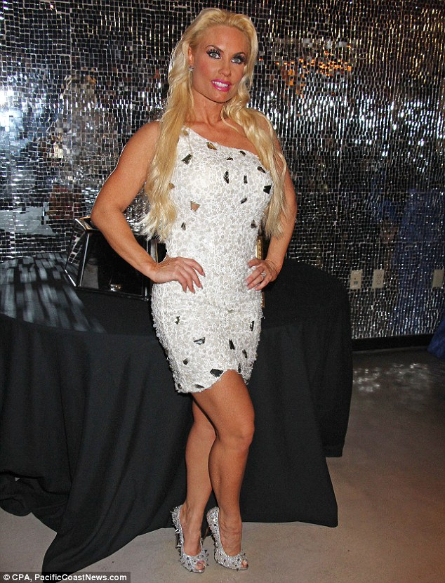 Angelic: Coco later changed into a tiny white beaded mindress as she prepared to party up a storm with her Peepshow co-stars