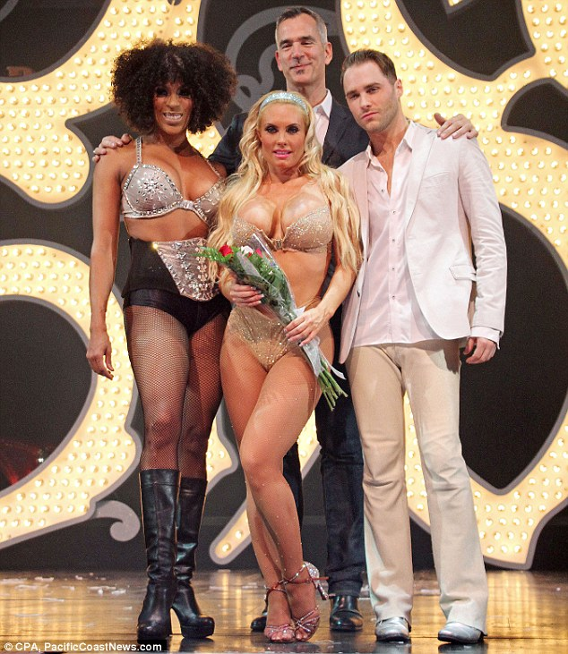 Congratulations: The blonde bombshell was presented with a bouquet of flowers on stage after her performance