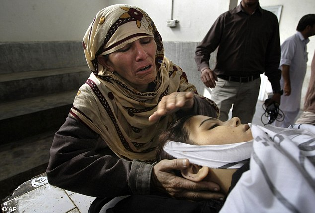 Rukhsana Bibi mourns over the body of her daughter, polio worker Madiha Bibi, at the morgue of local hospital in Karachi