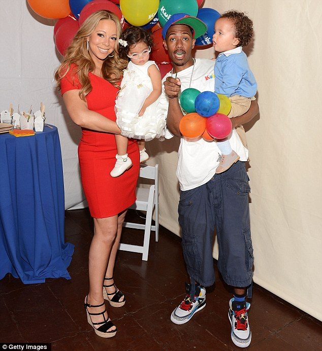 He's moved on: Nick with his wife Mariah Carey and their twins Monroe and Moroccan in October