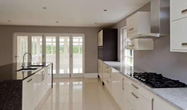 The new-build luxury sandstone property includes a huge kitchen with porcelain floors and bespoke granite work tops