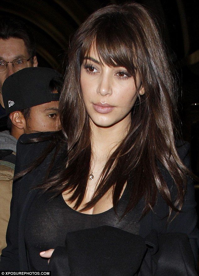 Touch down: Kim Kardashian debuted her new hairstyle on Wednesday as she arrived at LAX