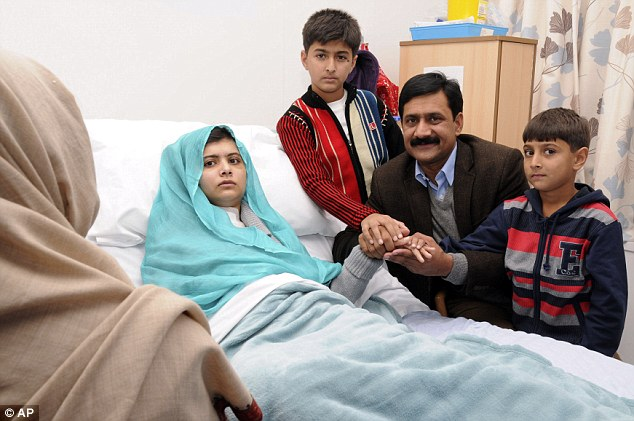 Shortlist: Obama also edged out Malala Yousufzai (pictured with her father and brothers), a 15-year-old Pakistani girl who was shot in the head by the Taliban for advocating girls' education