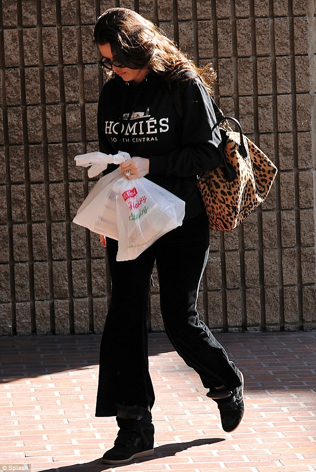 Sweatpants at half mast: Khloe Kardashian was seen running errands in Beverly Hills on Tuesday in a pair of bottoms that were a bit too small for her