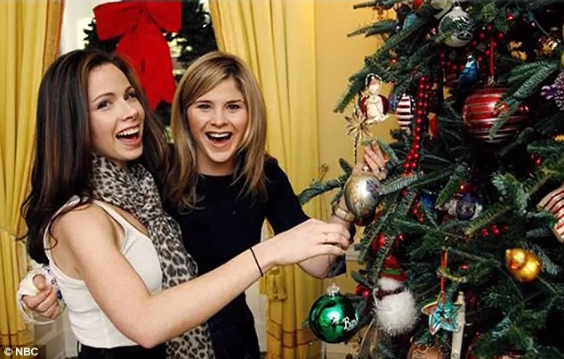 Sisters: Barbara, left, and Jenna Bush, right, pose next to the Christmas tree