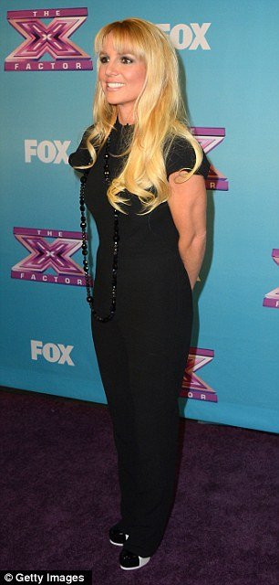 X-Factor judges Britney donned a surprisingly low-key black outfit for the big finale