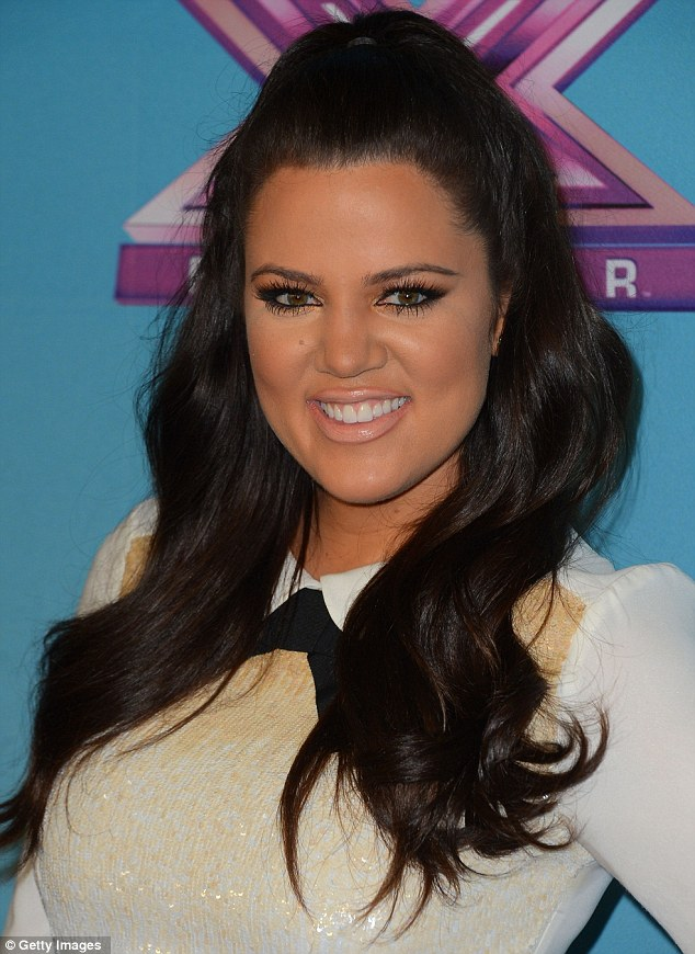 Fashionable girl: Khloe went for a more sophisticated look with the sequined shirt and bowtie